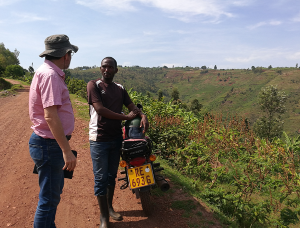 Two people discussing in the field in Rwanda